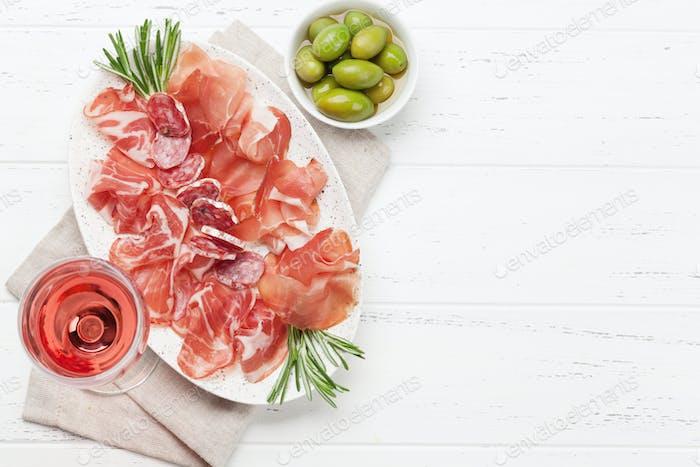 Spanish jamon, prosciutto and wine glass