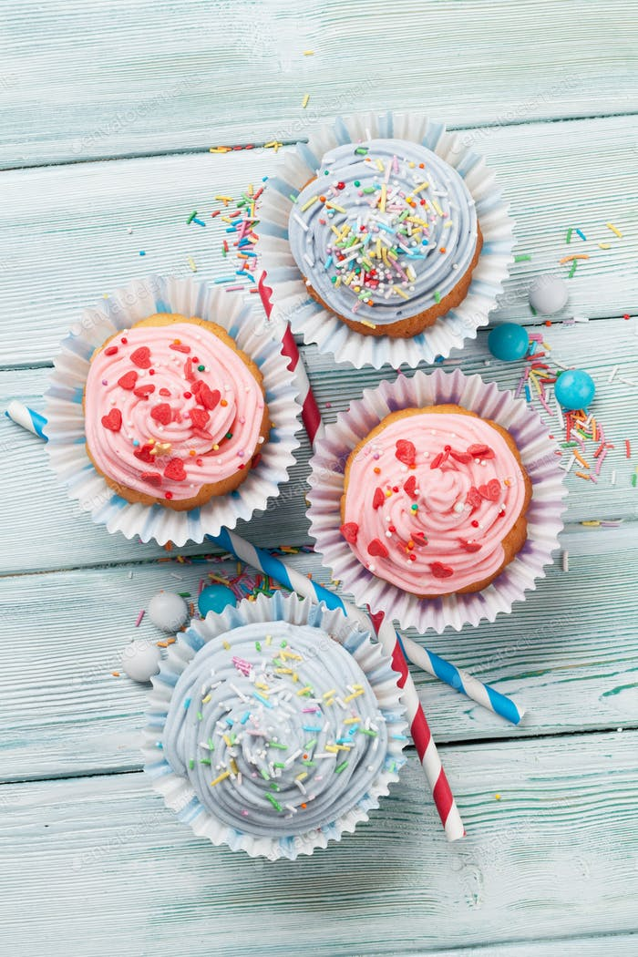 Sweet cupcakes with colorful decor