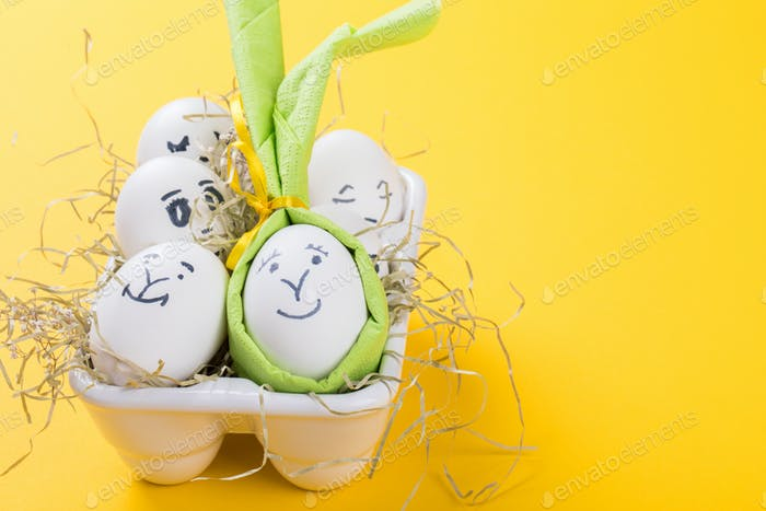 Easter holiday concept with cute handmade eggs.