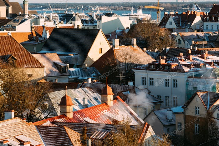 Tallinn, Estonia. Top View Of Old Tiles Roofs Of Residential Hou