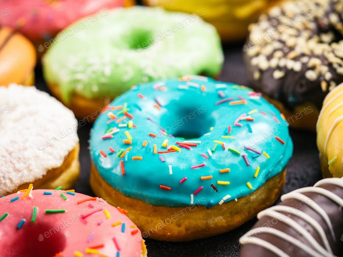 Close up view of assorted colorful donuts