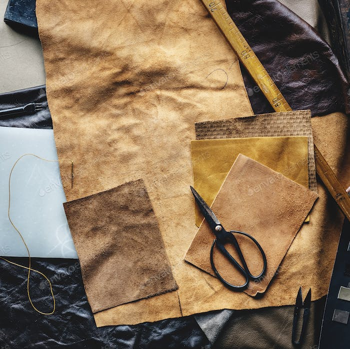 Aerial view of leather crafting with tools