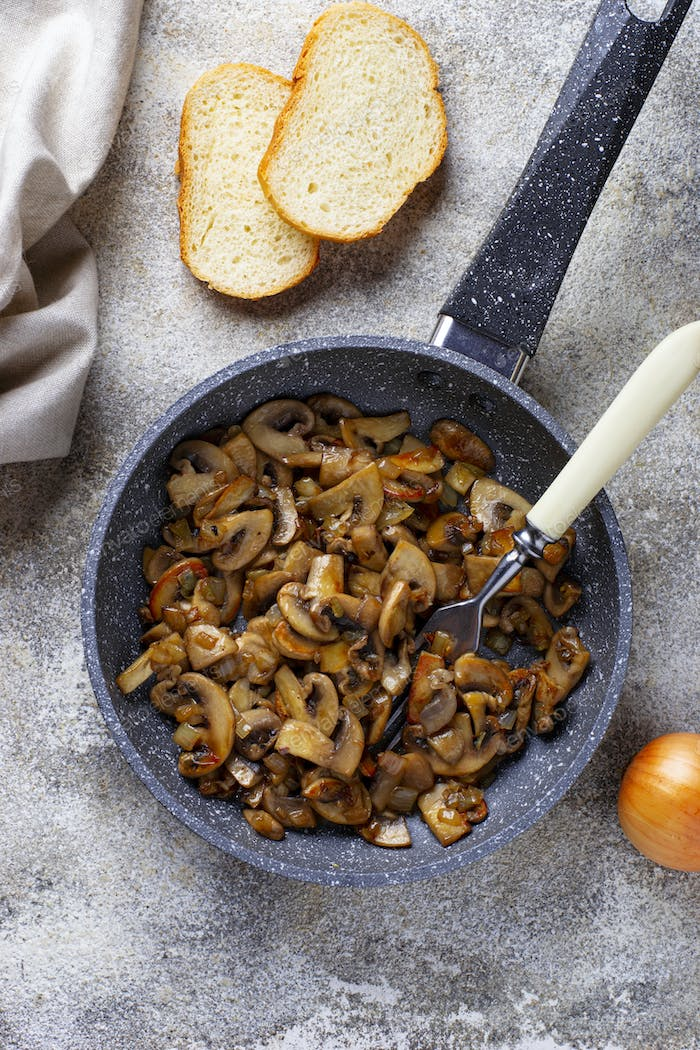Roasted mushrooms champignons in pan