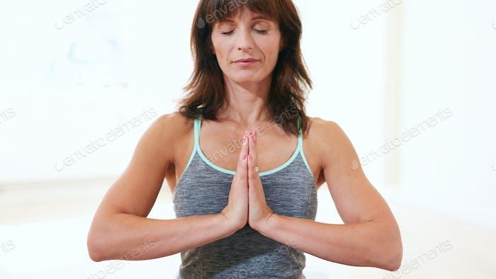Healthy woman practicing meditation yoga