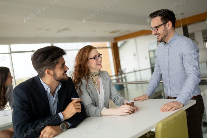Business people chatting and drinking coffee at a conference i
