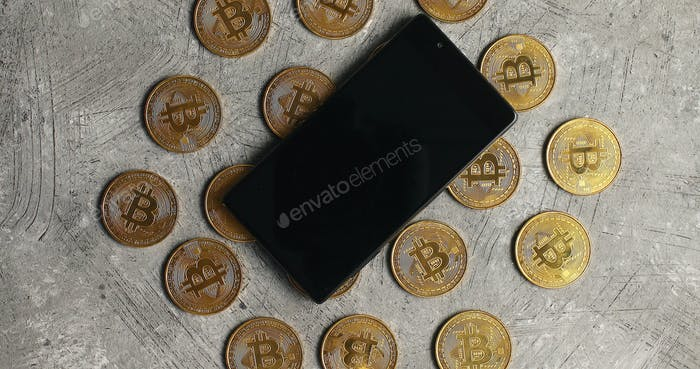 Smartphone and bticoin on gray background