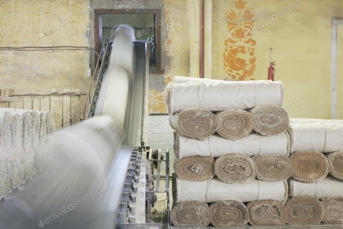 Canvas Rolls on a Conveyor