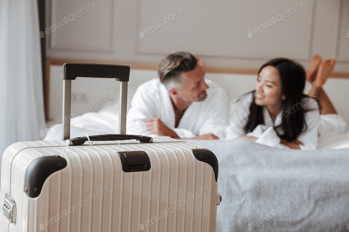 Image of blurry multiethnic couple man and woman wearing white b
