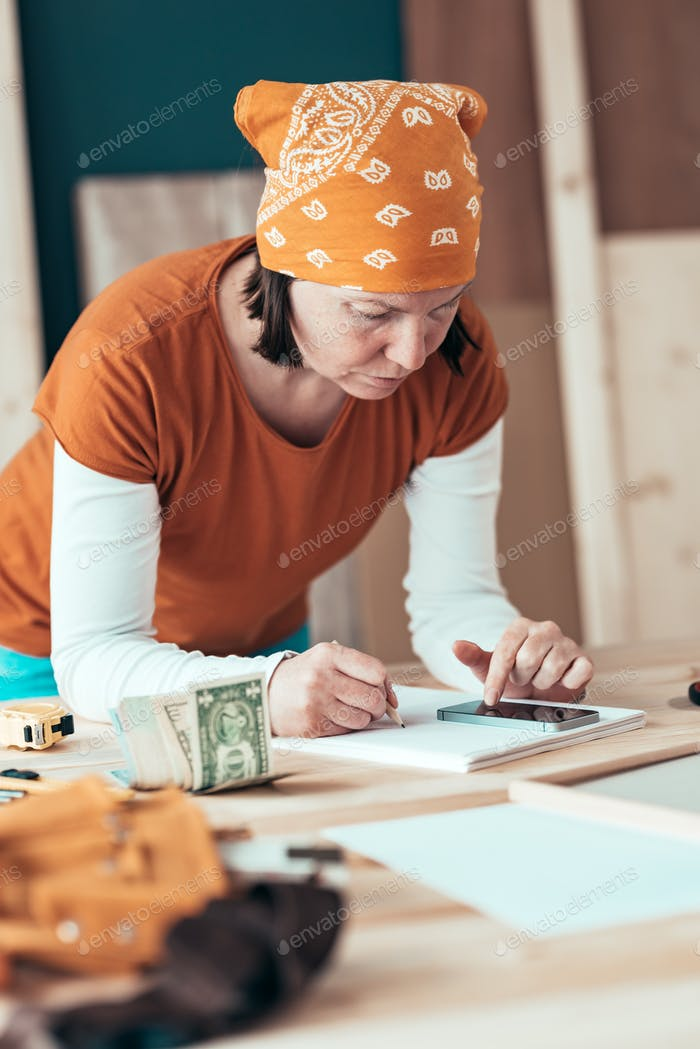 Female carpenter with financial problems