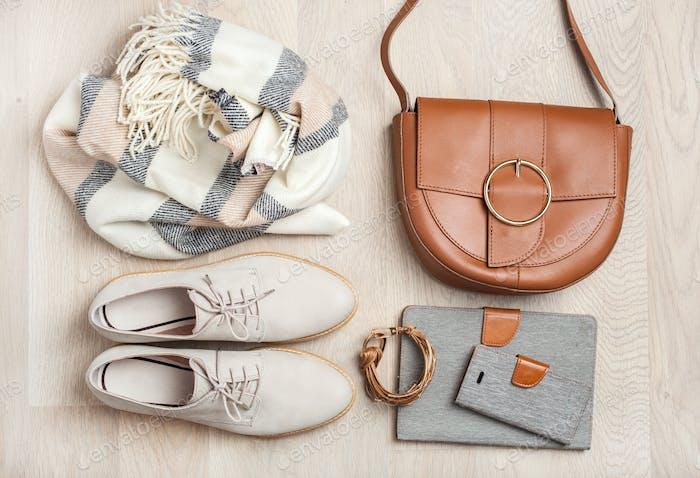 women's flat lay clothes shoes, scarf, bracelet, bag, tablet, sm
