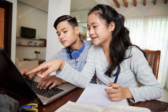 Siblings working on school project