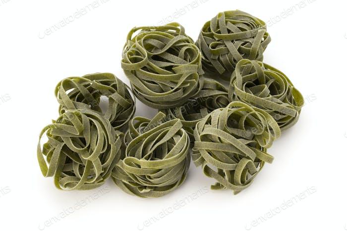 fettuccine pasta on white background