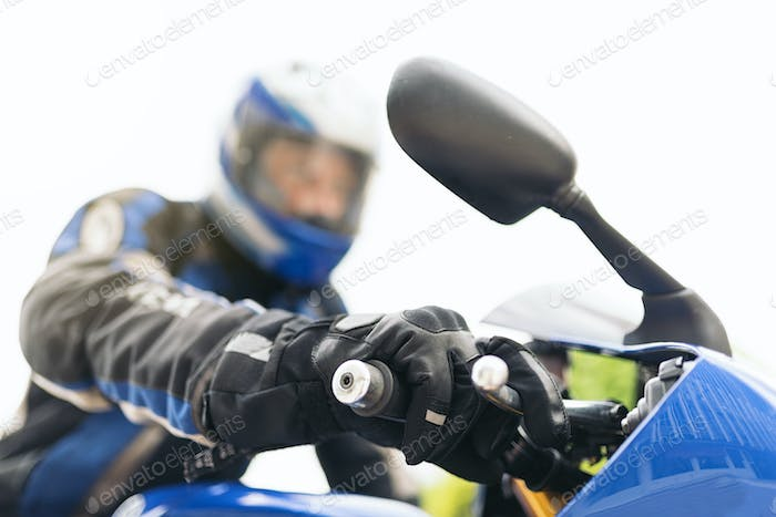 Motorcyclist driving his motorbike.