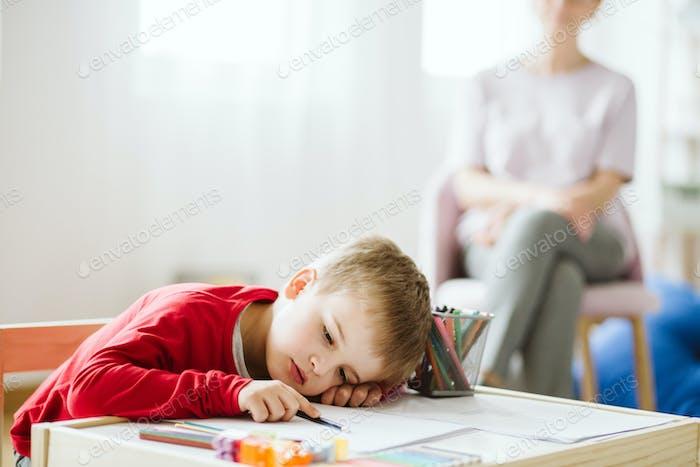 Tired boy at school