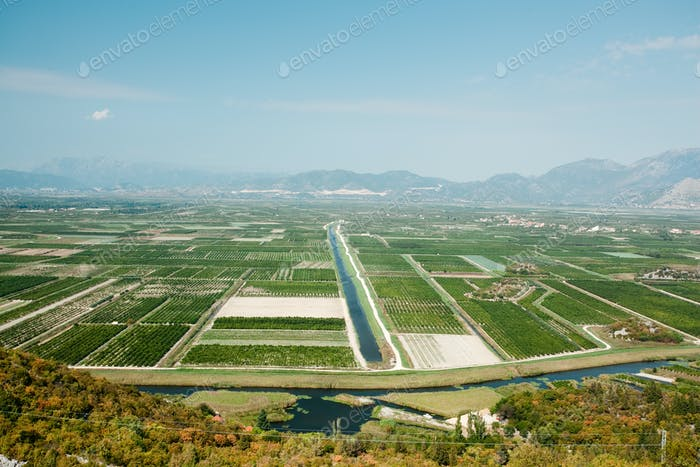 Aerial view of large areas of fertile land and crops in southern Croatia in Neretva river Valley