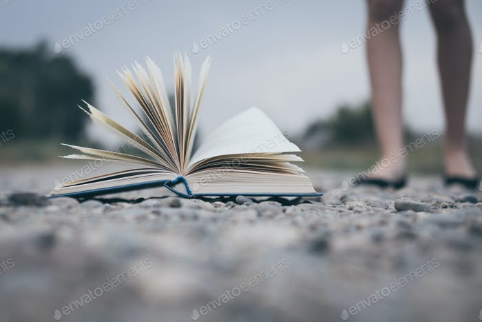 open book lying on the road.