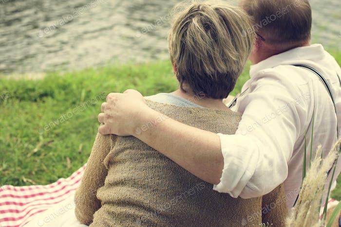 Elderly Couple Romantic Picnic Park Concept