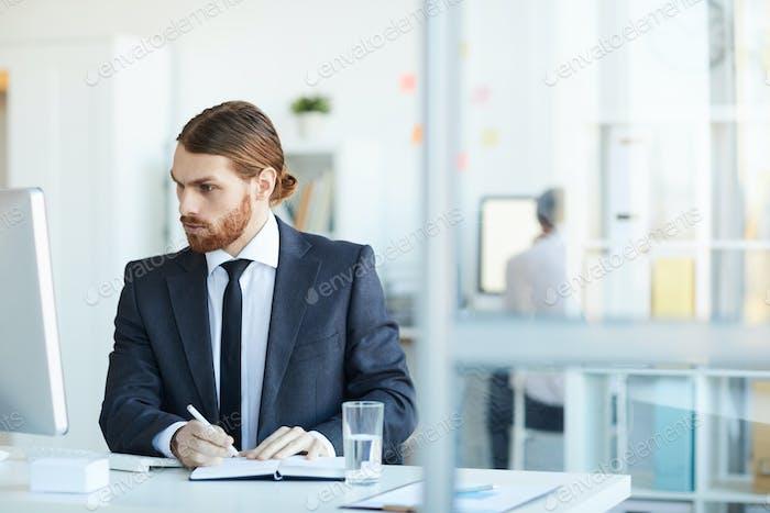 Young broker at work