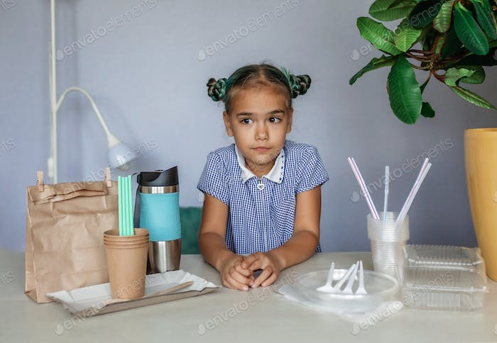 Plastic free and zero waste concept. Girl making a choice between plastic and paper set of dishes