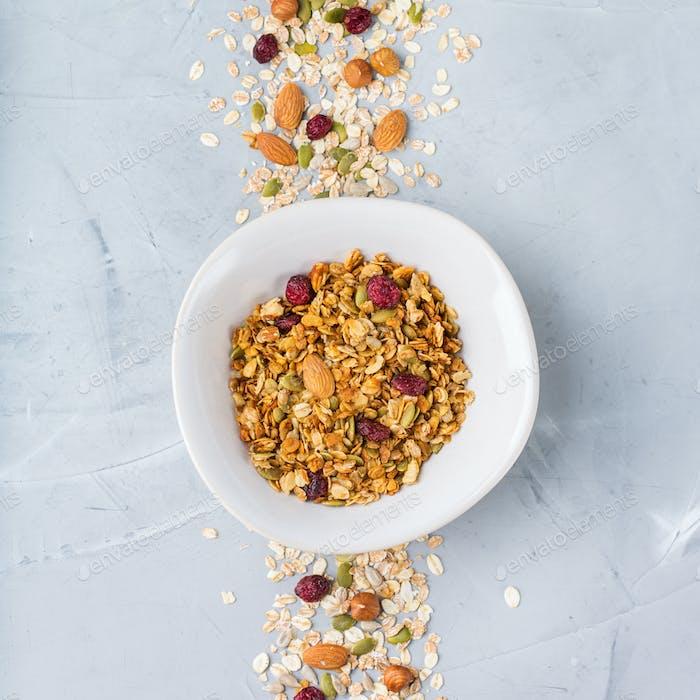 Homemade granola muesli with ingredients, healthy food for breakfast