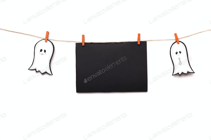 Creative Halloween paper ghosts holding black label for text