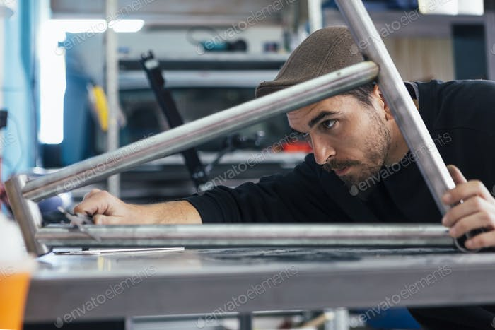 Man working with metal bars