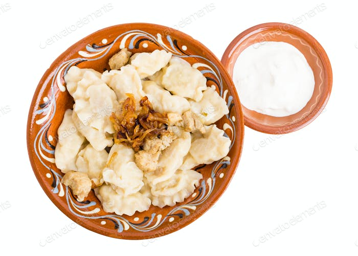 Russian dumplings pelmeni with meat.