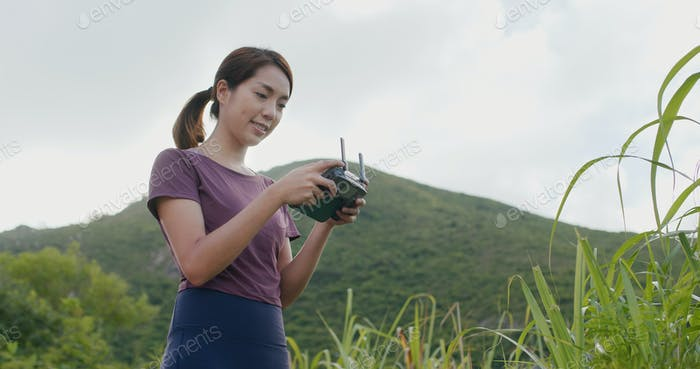 Woman play drone at outdoor