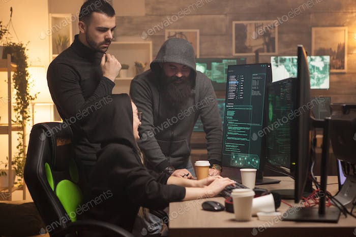 Team of men and female hackers making a dangerous malware