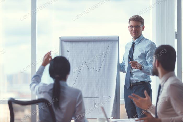 Young business people at a presentation