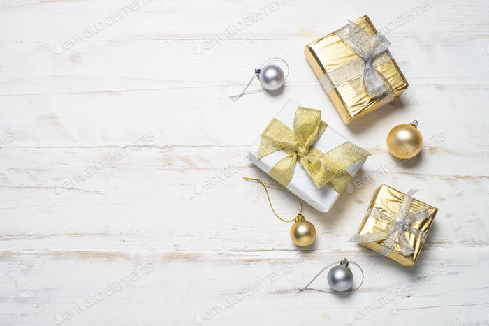 Gold and silver christmas present box and decorations on white