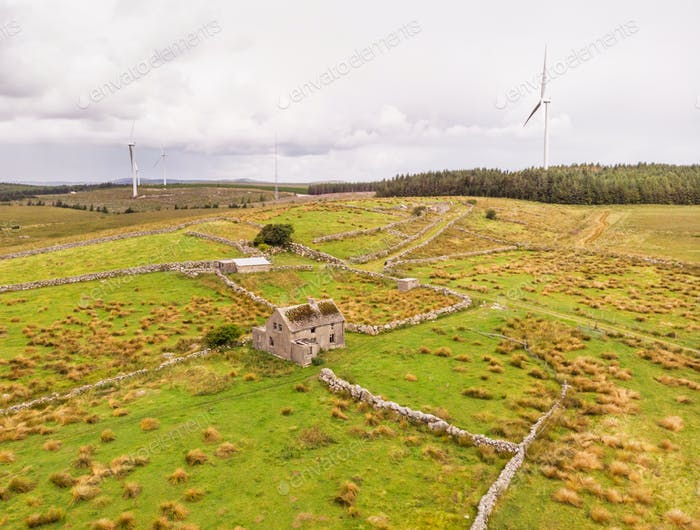 Abandoned Irish Farm House and Wind Turbines