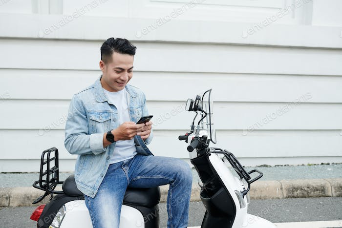 Moped Driver Communicating Online
