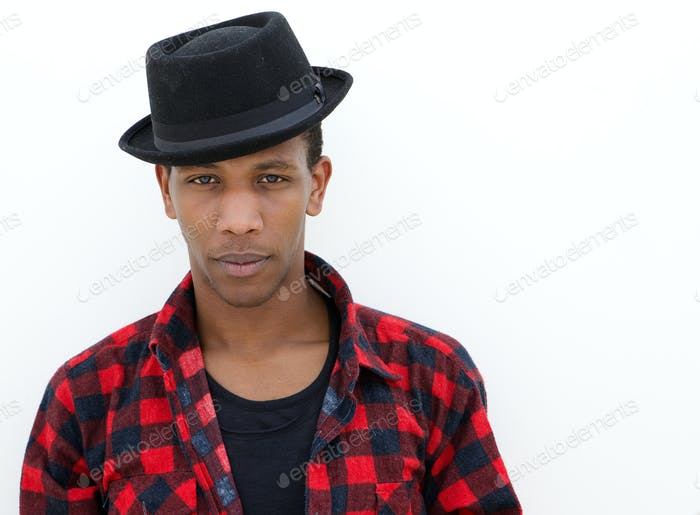 Confident young man with hat