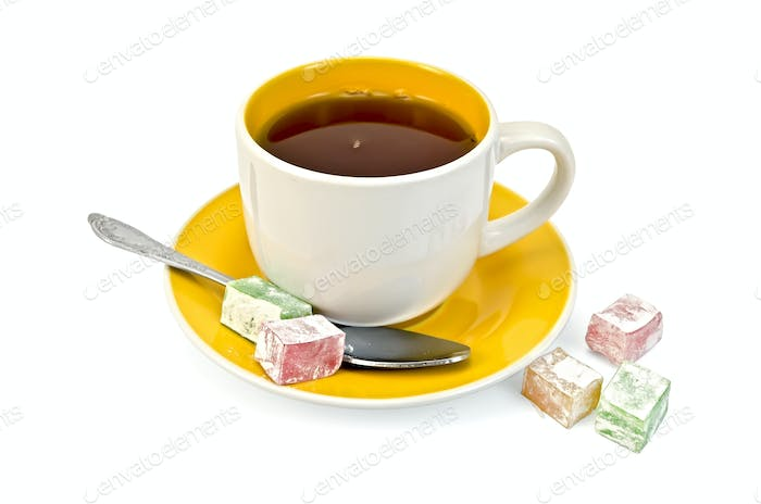 Tea in yellow cup with lokum
