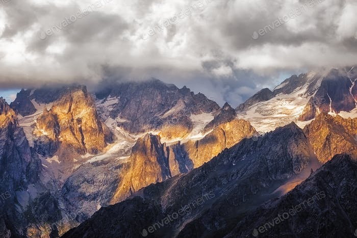 Detail of dramatic mountain range with colorful sunlight, Svaneti, Georgia