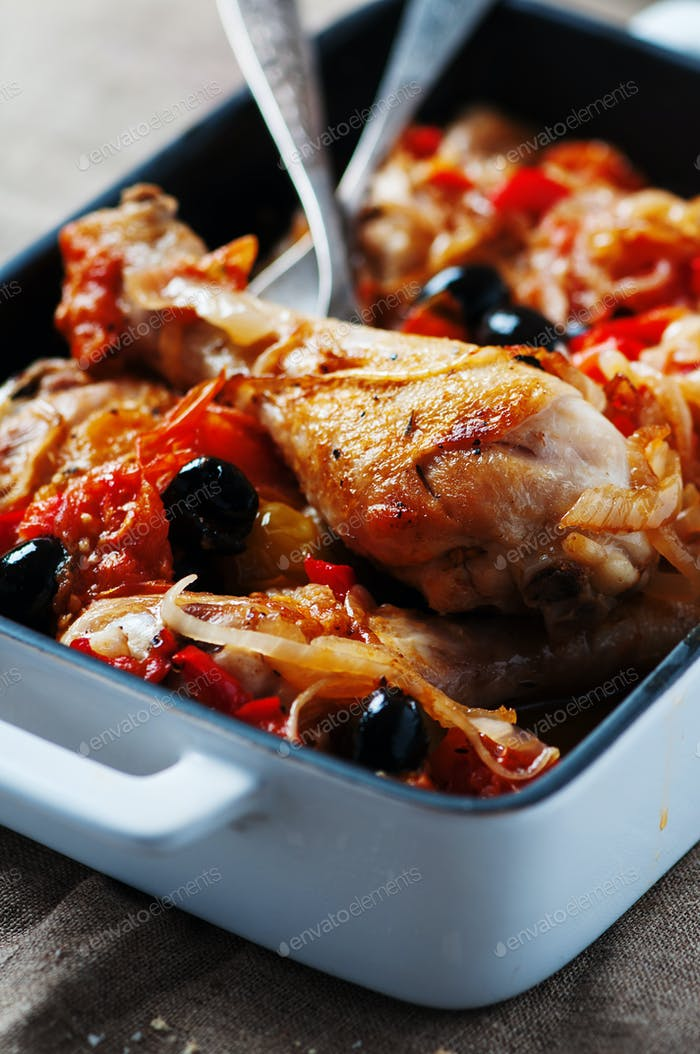 Cooked chicken with tomato, onion, pepper and olive