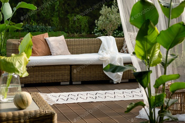 Rattan sofa on porch