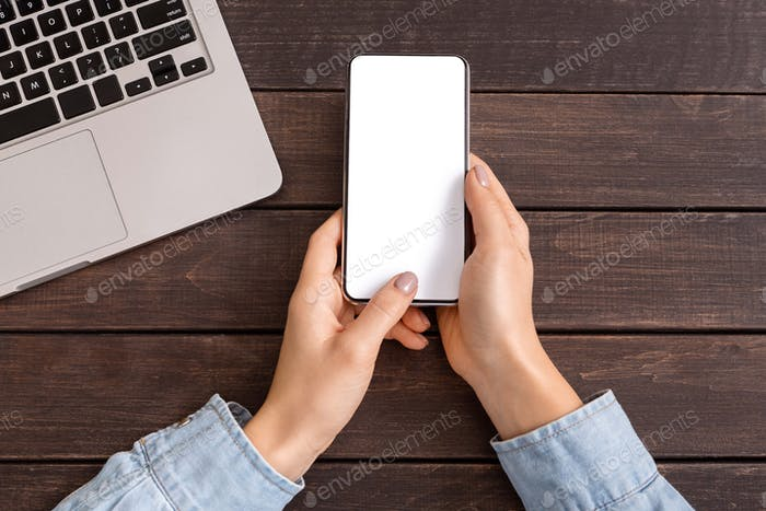 Smartphone with blank screen for your advertising in woman's hands