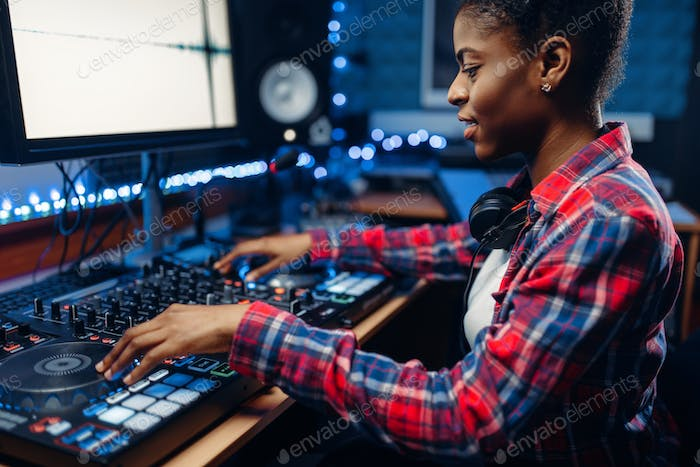 Female sound engineer in the recording studio