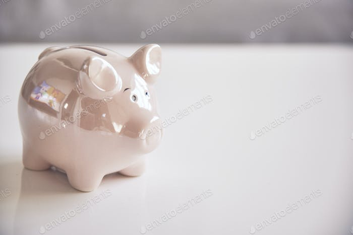 Piggy bank on an white table