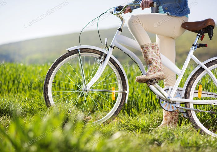 Detial of young woman with bike