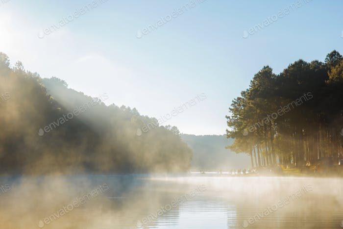 Sunrise at fog on lake