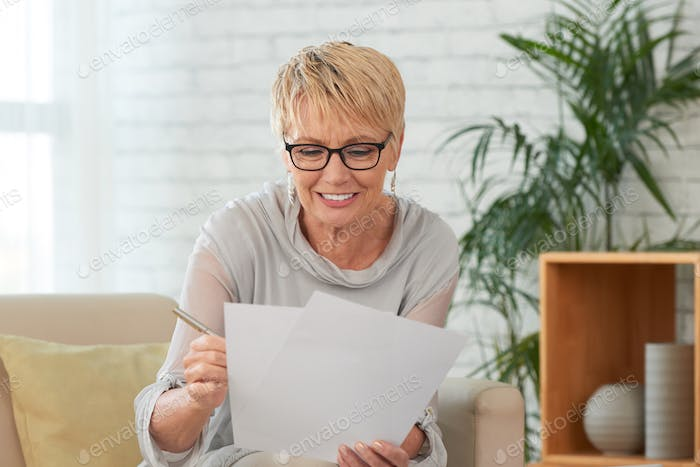 Aged woman reading document