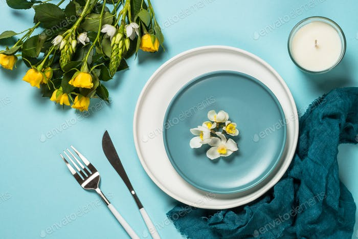 Spring table setting with flower top view