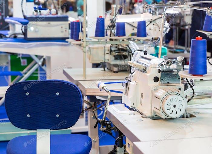Sewing machine, nobody, clothing sew on fabric