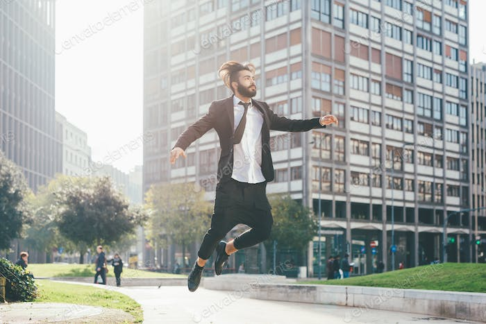 Thumbnail for Young handsome businessman jumping