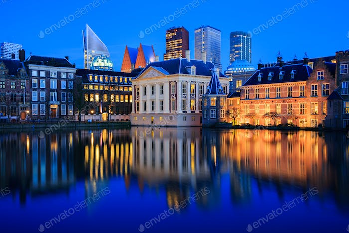 The skyline of the Hague and a lake at Blue Hour