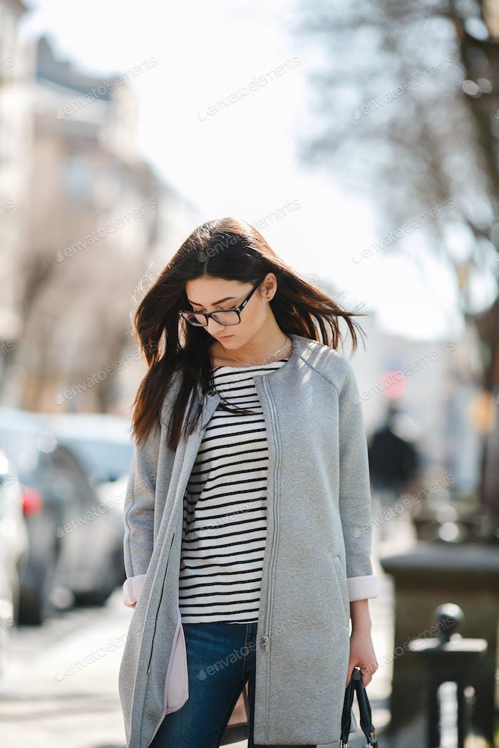 Beautiful model walks in europian city.