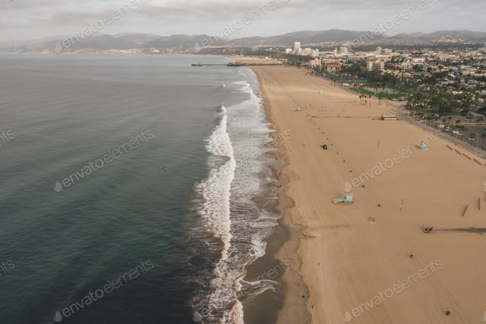 Beautiful Wide View over Manhattan Beach in California with Waves crashing onto Beach